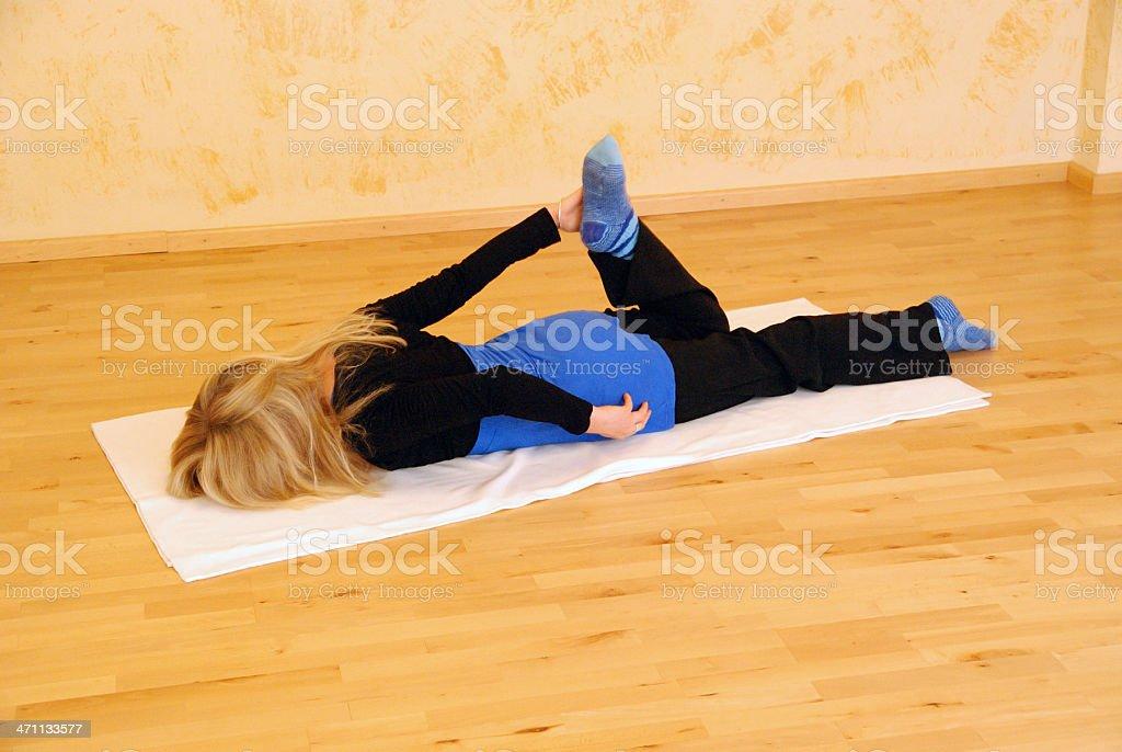 yoga woman indoor on floor stock photo