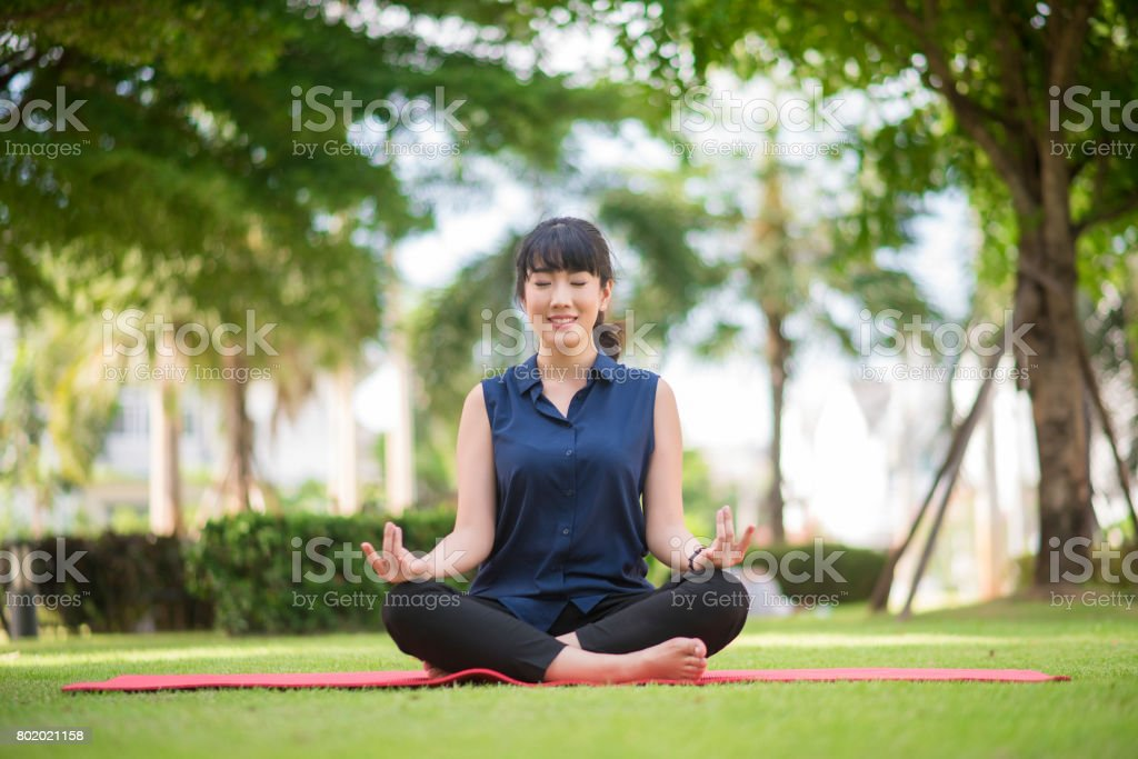 yoga woman on green park stock photo