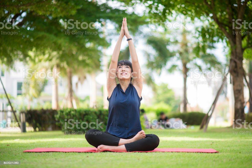 yoga woman on green park stock photo