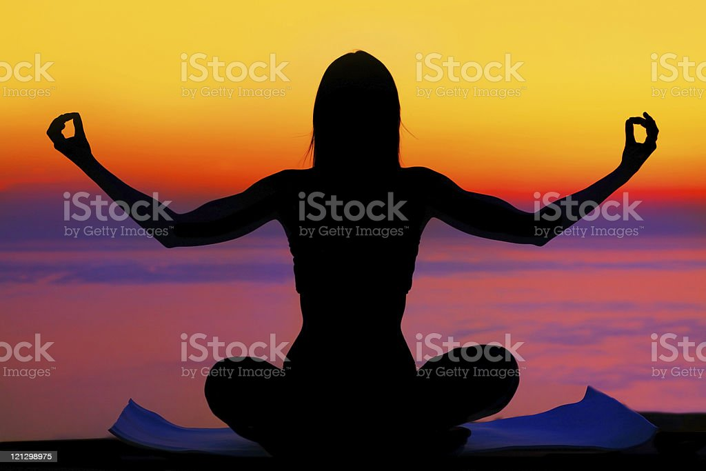 Yoga woman over sunset royalty-free stock photo