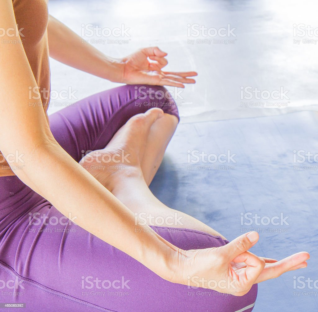 Yoga woman sitting with legs crossed stock photo
