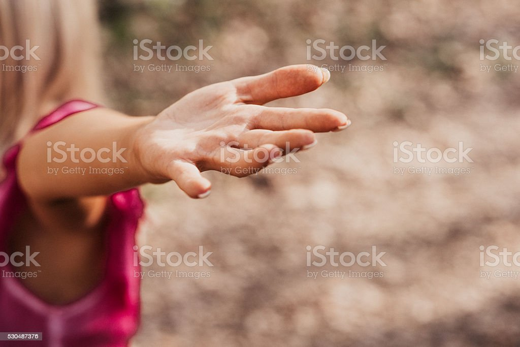Yoga woman stretching out her arms focus on hand stock photo