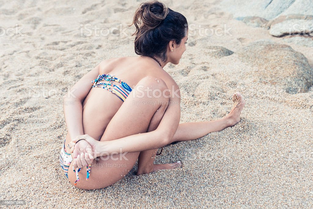 Yoga Woman with Flexible Body on Sandy Beach stock photo