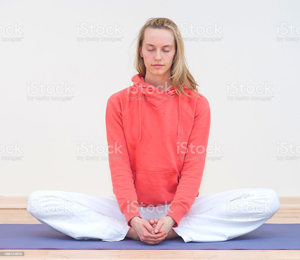 yoga woman with red dress in tranquill scene stock photo