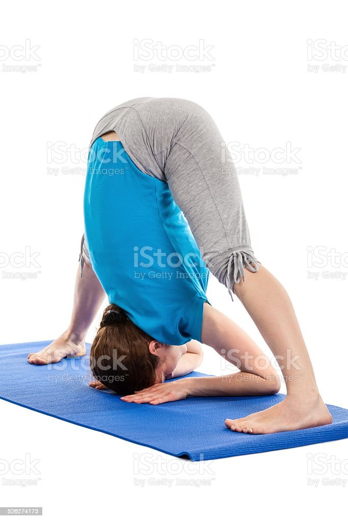 Yoga - young beautiful woman doing asana excerise isolated stock photo
