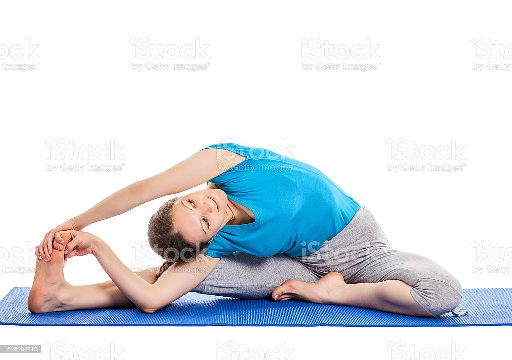 Yoga - young beautiful woman doing asana excerise isolated stock photo