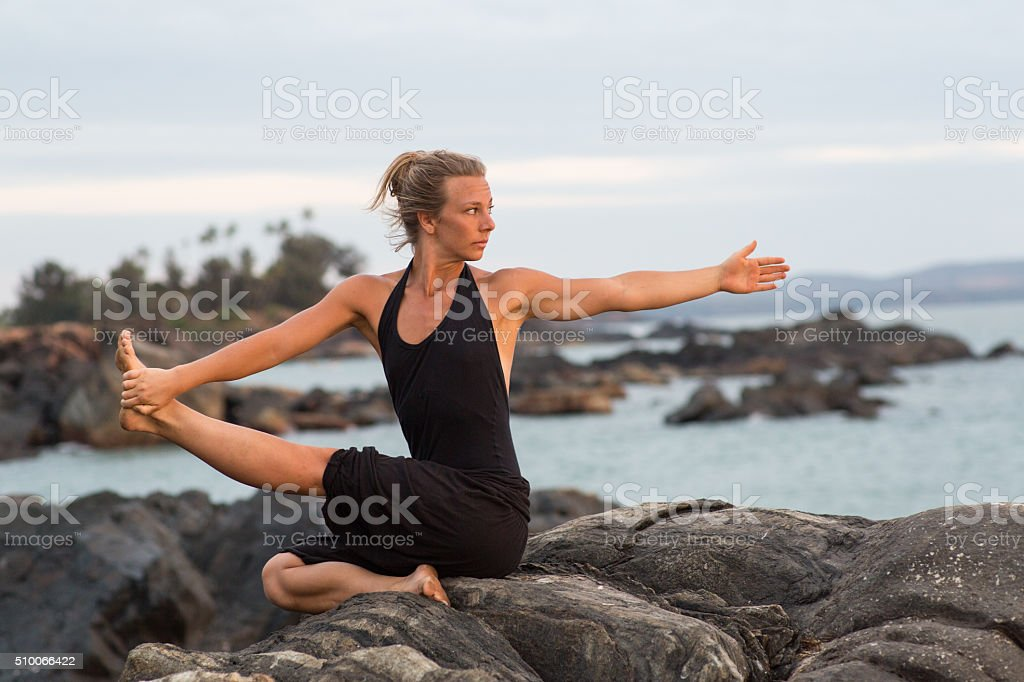 Yoga_girl_ocean stock photo