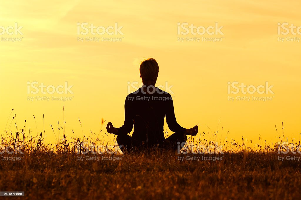 Yoga-Ardha Padmasana/Half-lotus pose stock photo