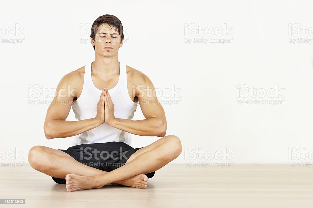 Yogatic man meditating with his hands joined royalty-free stock photo