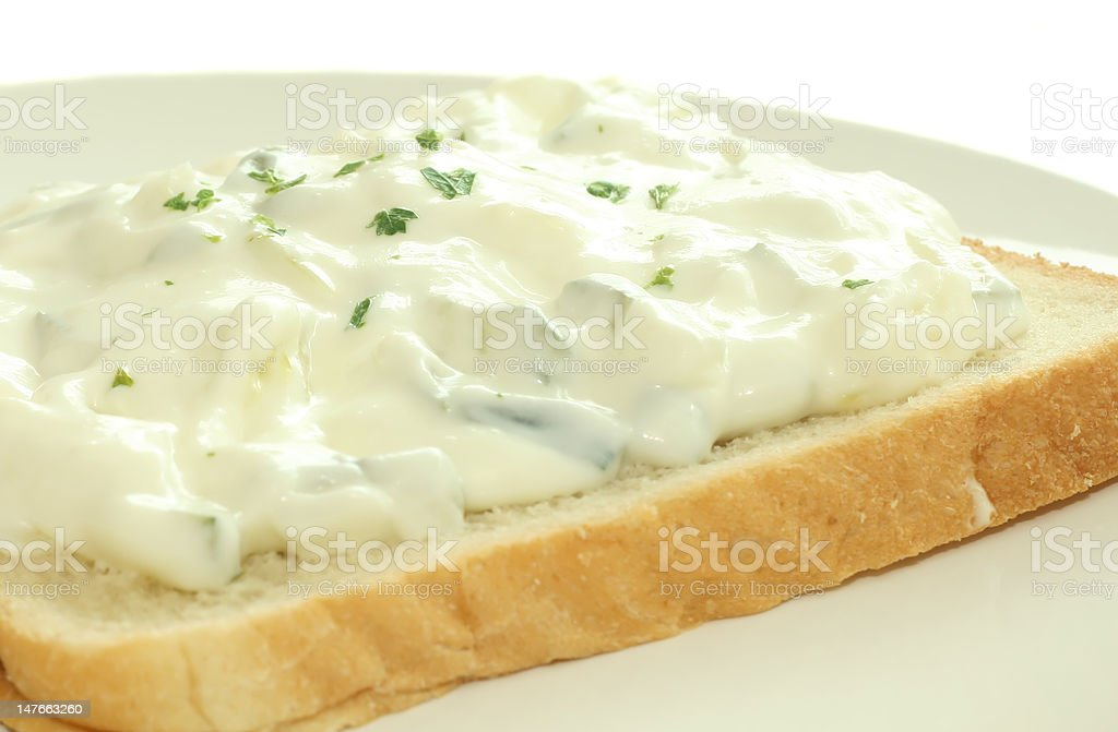Yoghurt with cucumbers and garlic for salad stock photo