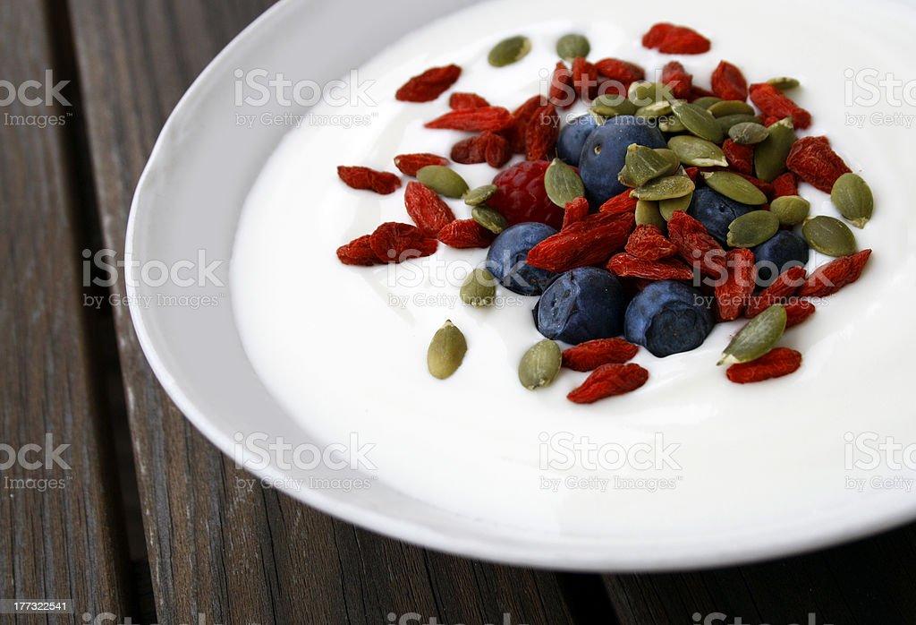 Yoghurt with goji berries / wolfberry royalty-free stock photo