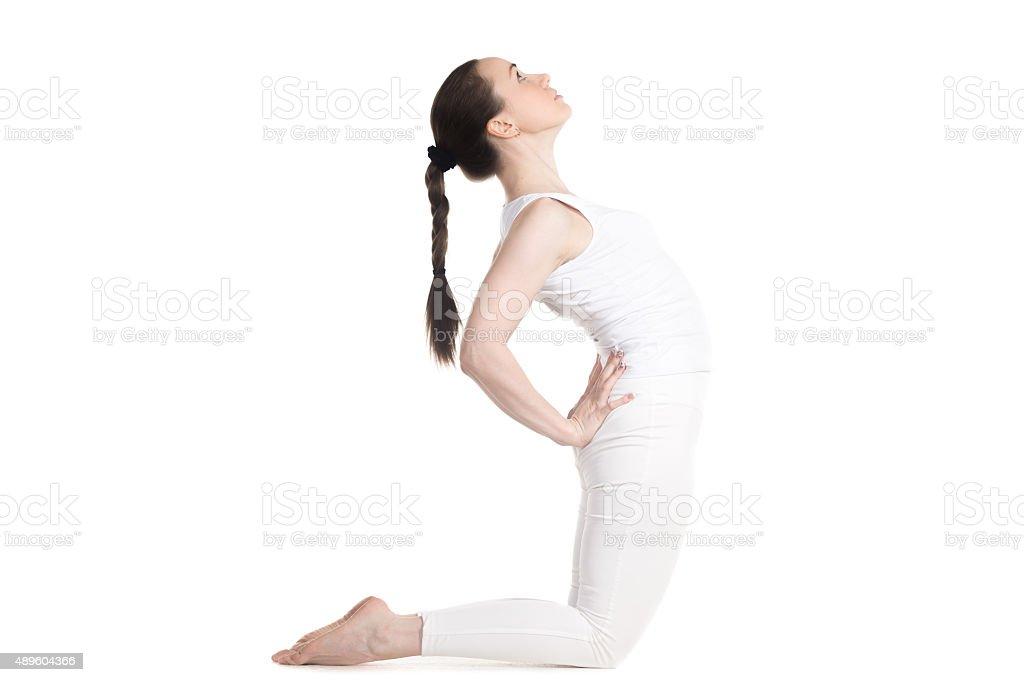 Yogi female doing Camel Pose stock photo