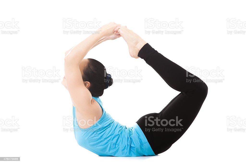 Yogi female in yoga asana dhanurasana stock photo