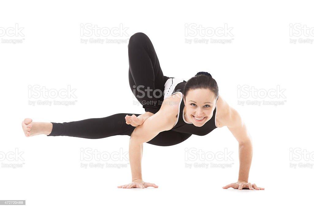 Yogi female in yoga asana Parivritta Eka Pada Koundinyasana stock photo