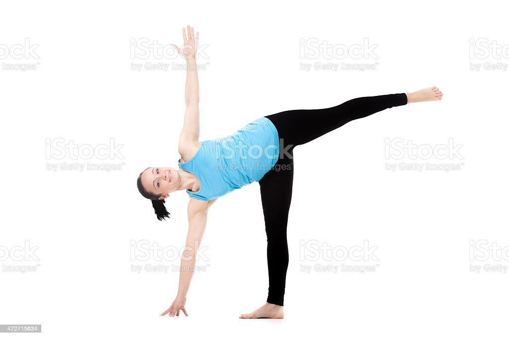 Yogi female in yoga Pose Ardha Chandrasana stock photo