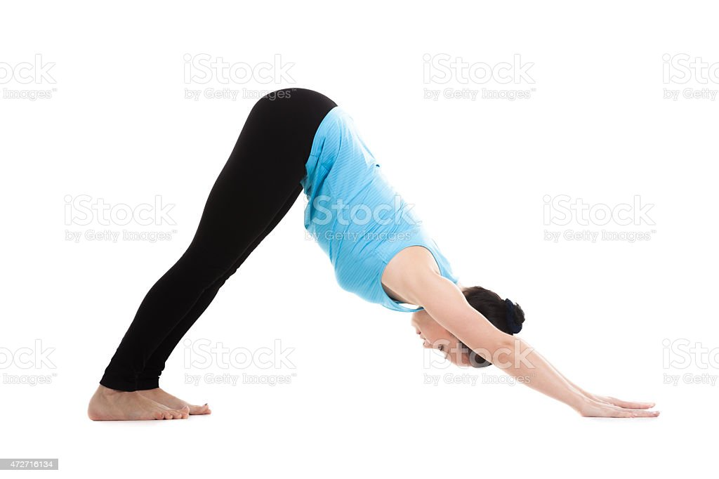 Yogi female in yoga pose ardha mukha shvanasana stock photo
