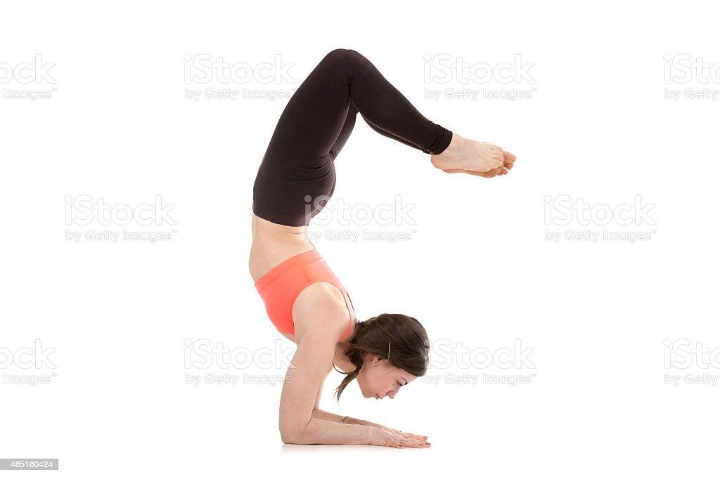 Yogi female in yoga Scorpion Pose Vrischikasana 1 stock photo