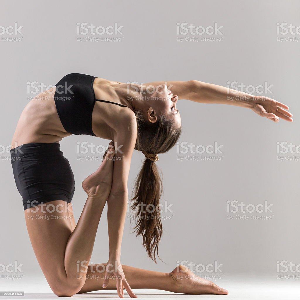 Yogi gymnast girl doing asana Ustrasana or Camel Pose stock photo