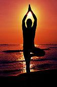 yogi man doing the yoga tree pose