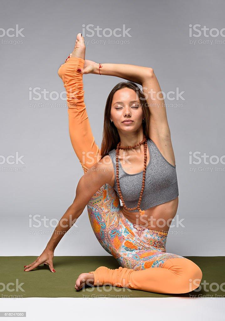 Yogi sitting on mat stock photo