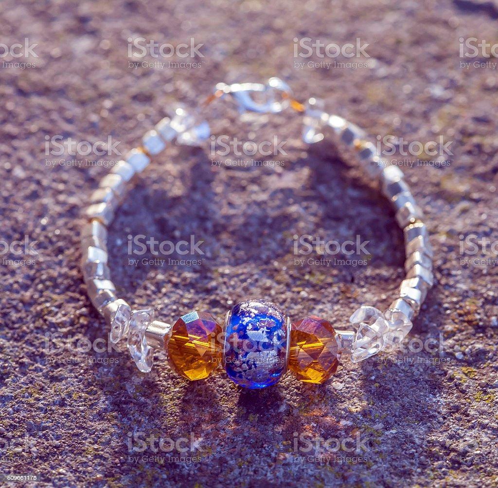 Yogini bracelet with arcistic glass bead stock photo