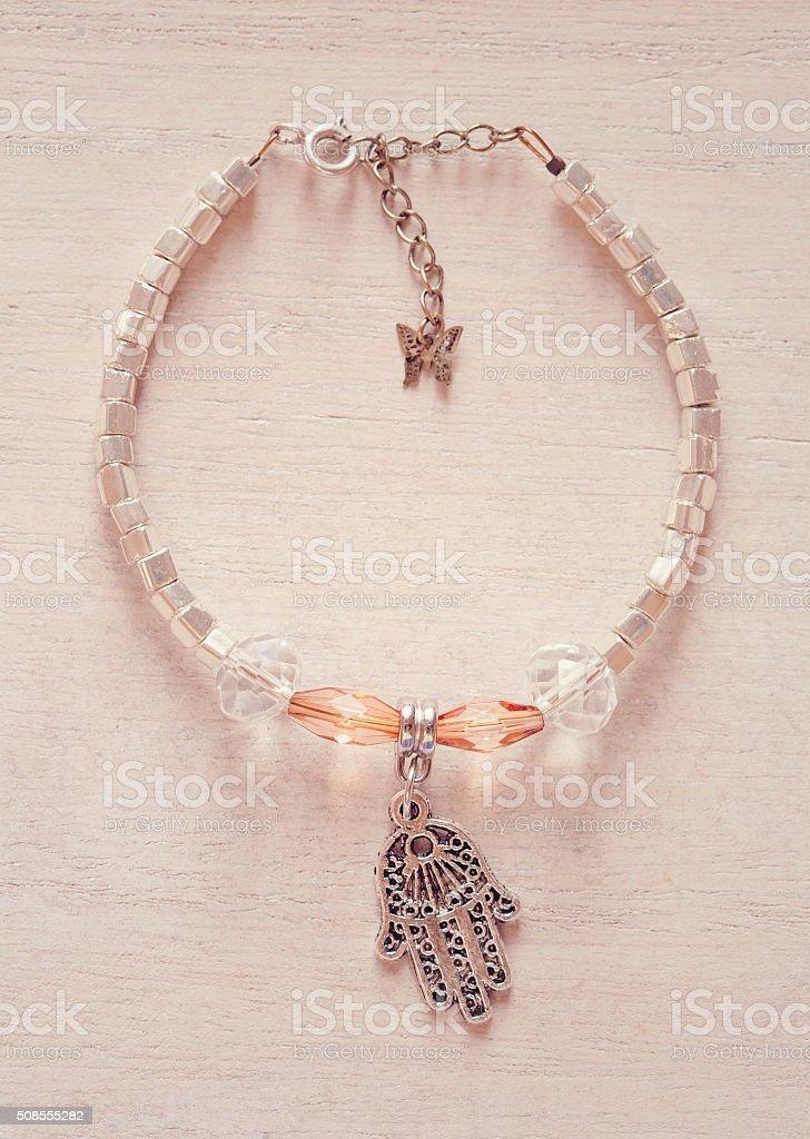 Yogini bracelet with Fatima's hand pendant stock photo