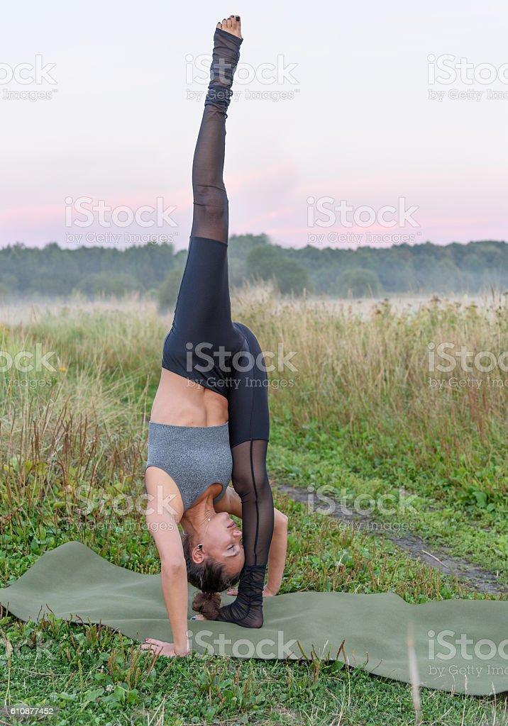 Yogini stands upside down stock photo