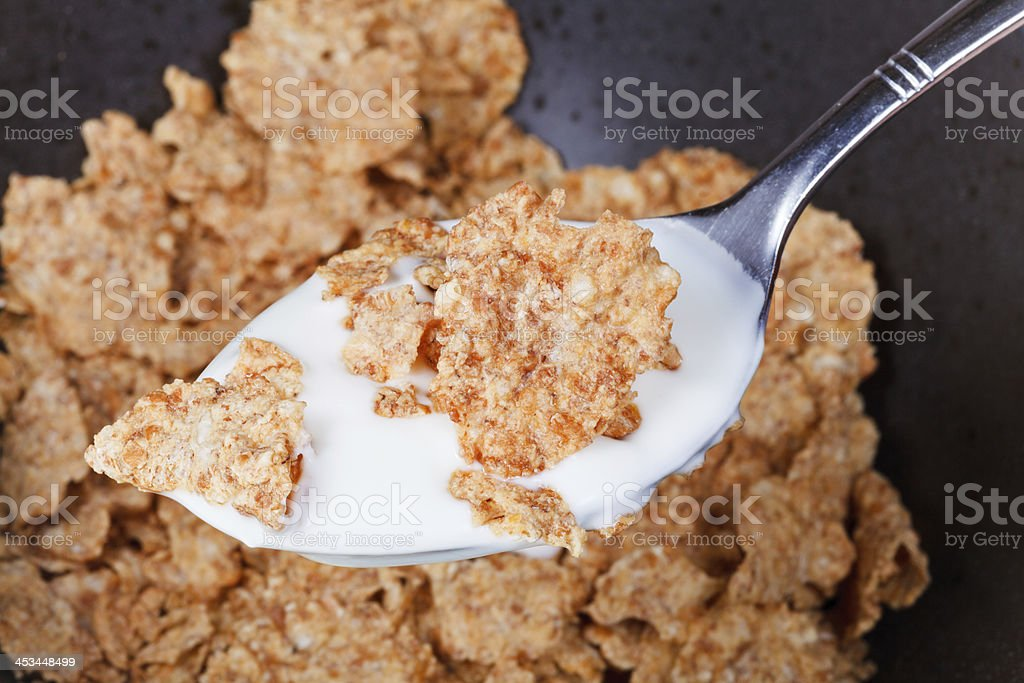 yogurt and flakes in spoon royalty-free stock photo