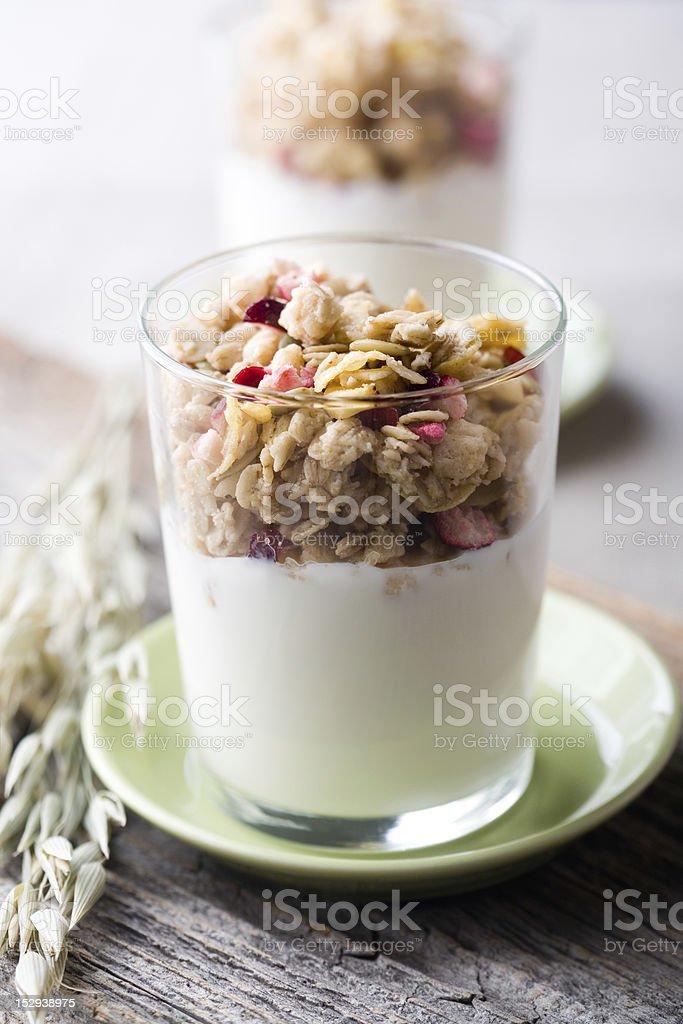 Yogurt and granola in a glass stock photo