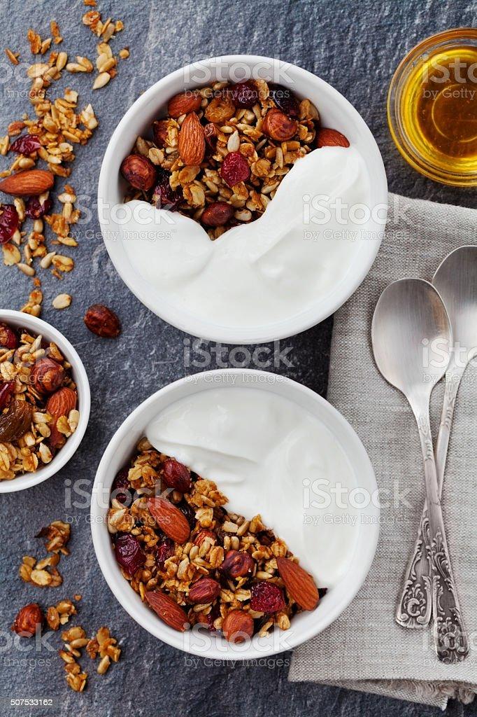 Yogurt bowl with granola on black table stock photo
