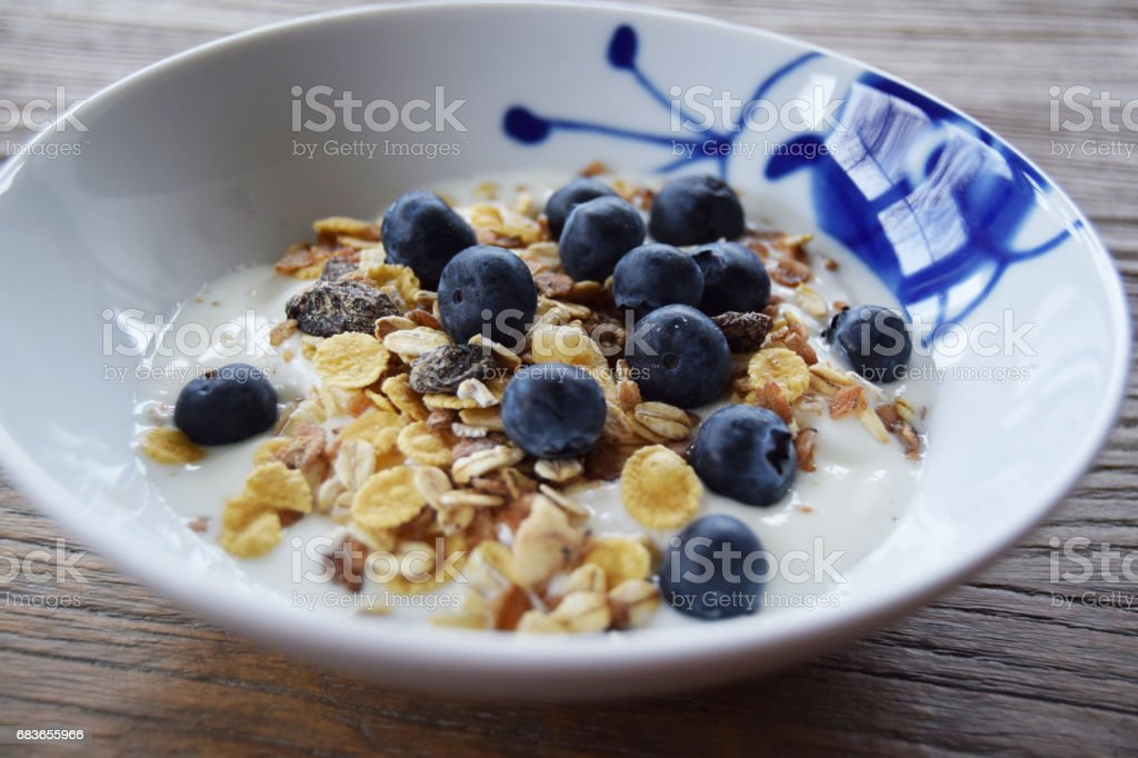 Yogurt, cereal and blueberries stock photo