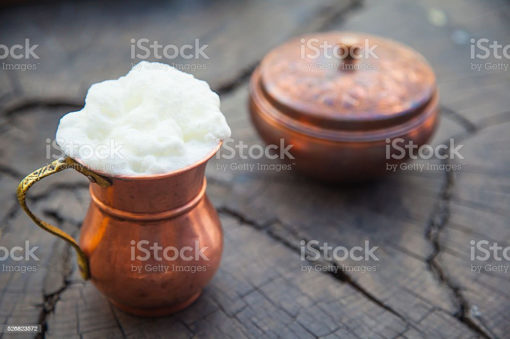 Yogurt drink on old wooden table stock photo