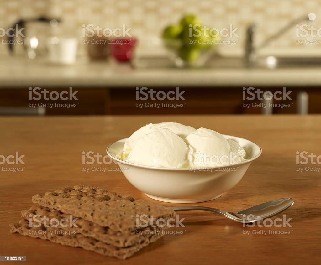 Yogurt in a bowl on the kitchen table royalty-free stock photo
