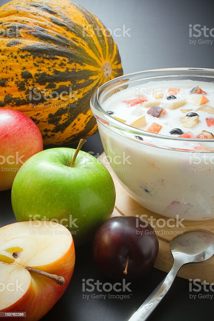 Yogurt mixed with fruit pieces royalty-free stock photo