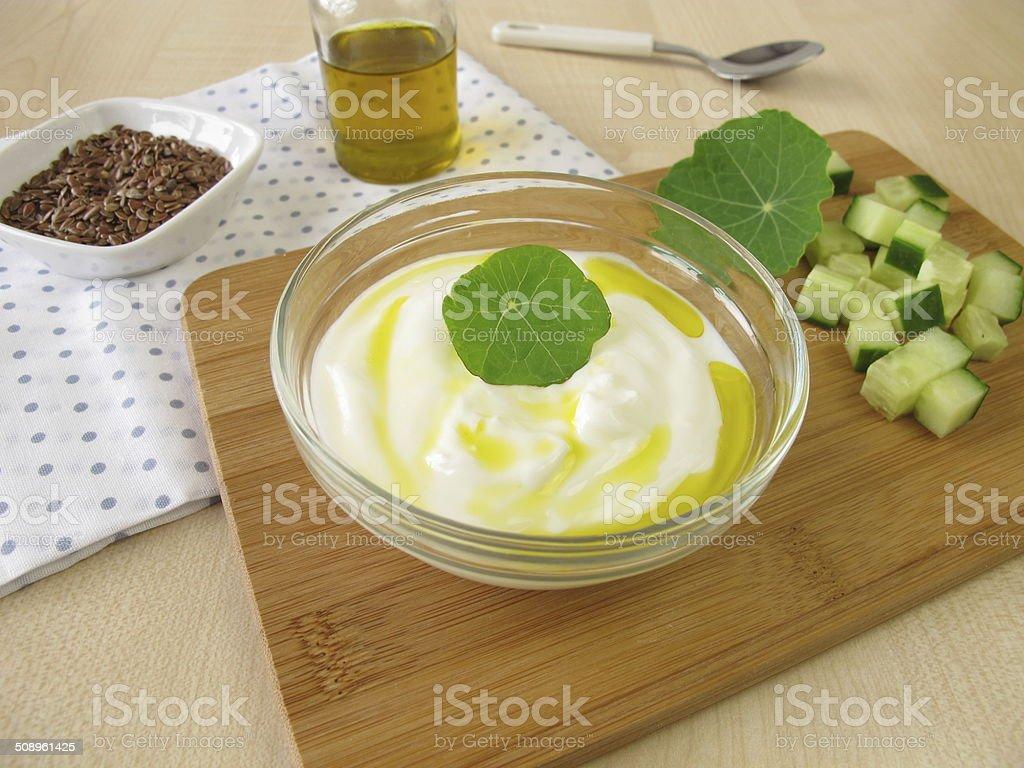 Yogurt with flaxseed oil stock photo