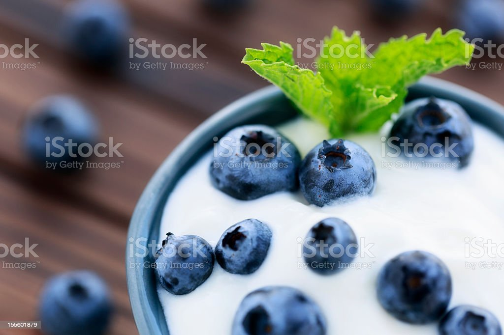 Yogurt with fresh blueberries and a mint garnish stock photo