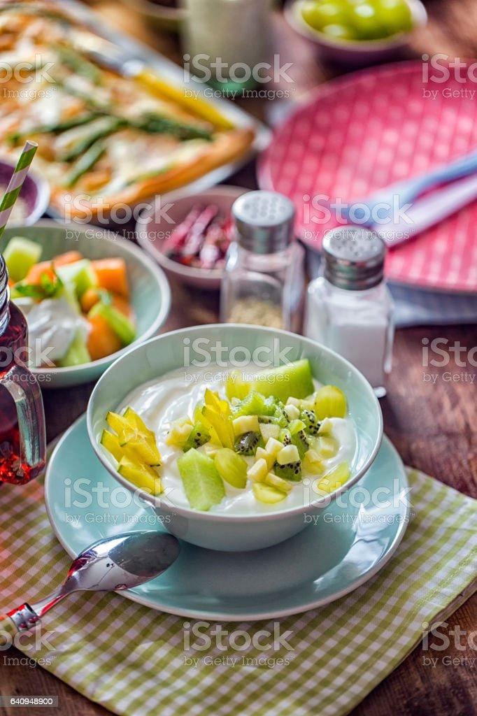 Yogurt with Green Fruits stock photo