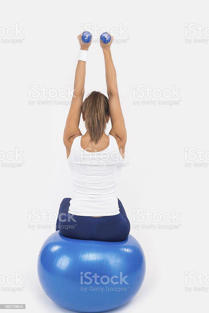 Yoing women doing weight training royalty-free stock photo