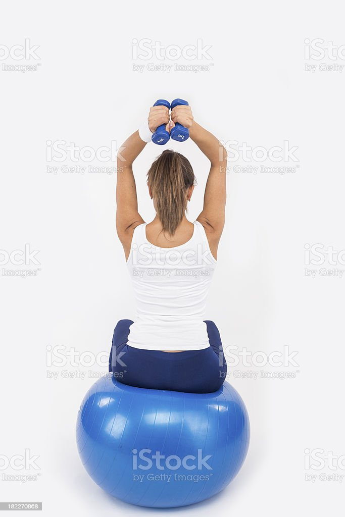 Yoing women doing weight training royalty-free stock photo