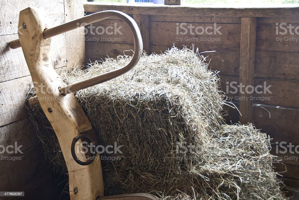 Yoke and bales of hay in a barn stock photo