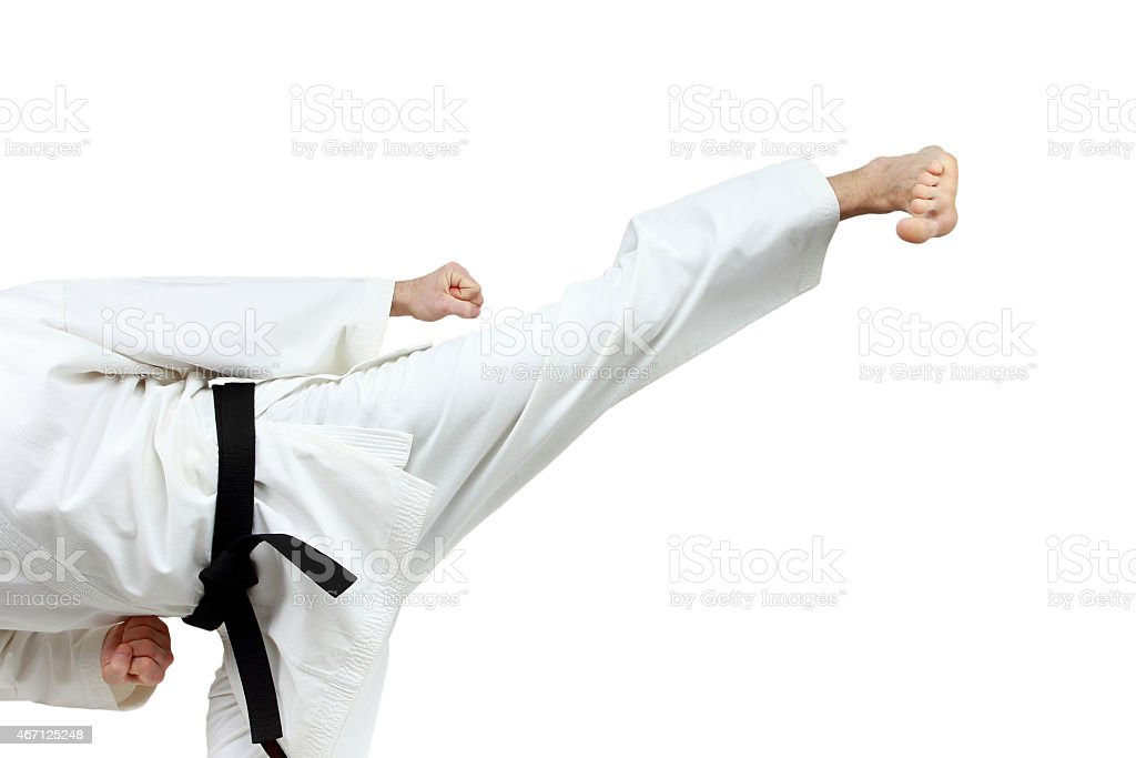 Yoko-geri in perfoming an athlete in karategi stock photo