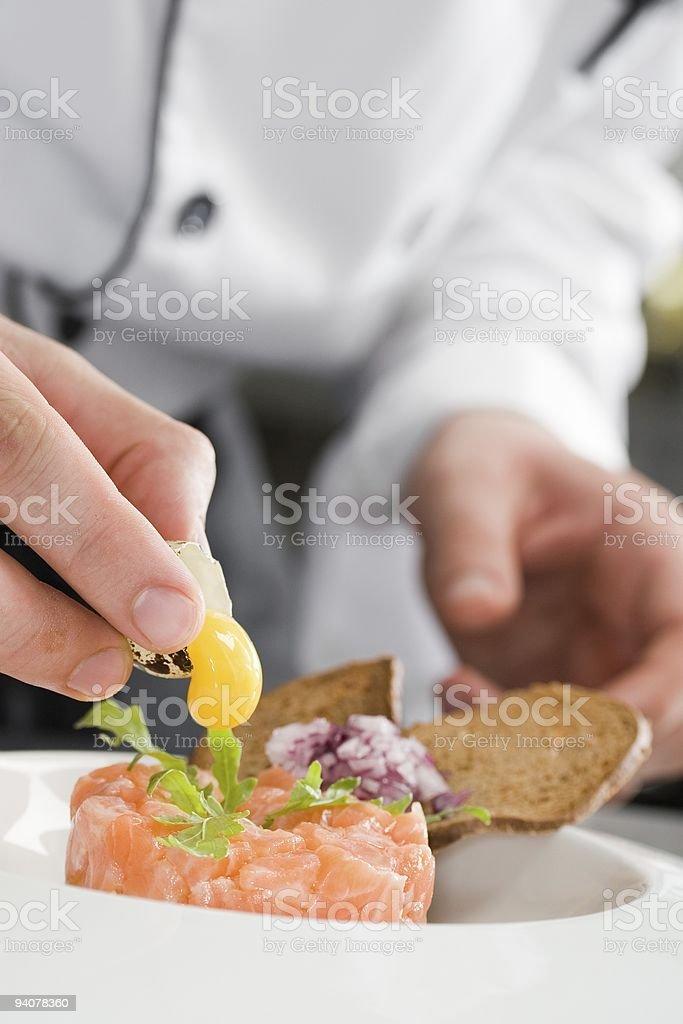 Yolk falling down on a salmon salad stock photo