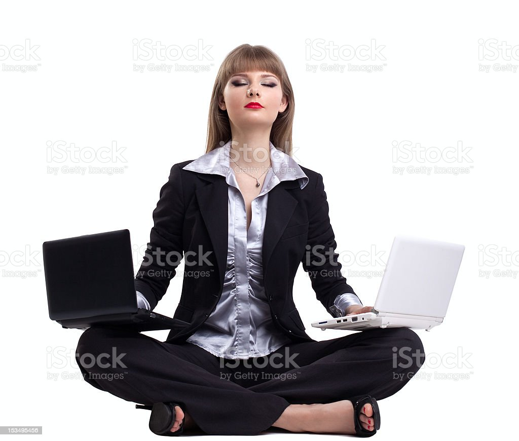 Yong business woman in yoga with two laptop royalty-free stock photo