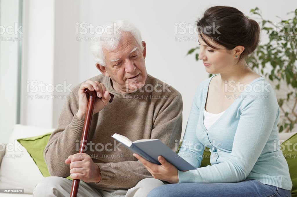 Yong carer reading book stock photo