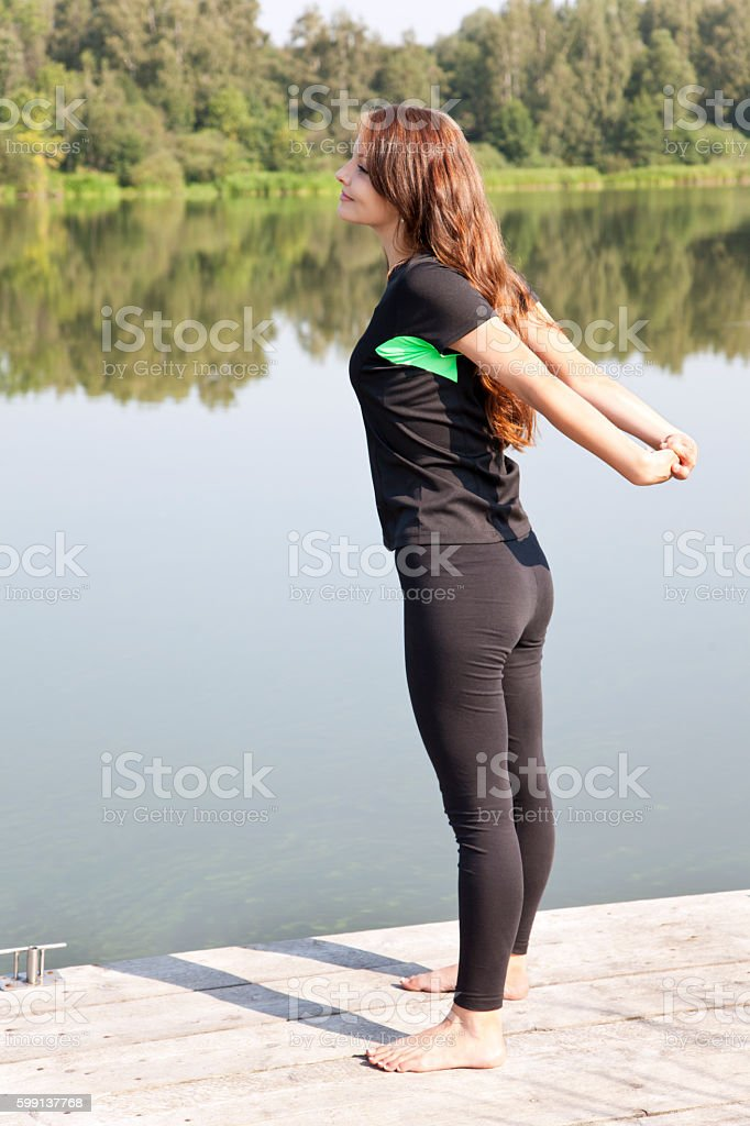 Yong woman performs stretching relaxation stock photo