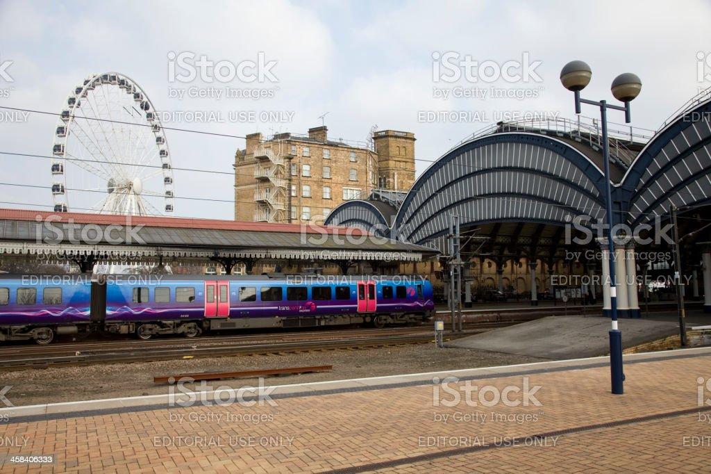 York Railway Station First Trans Pennine Train and Big Wheel stock photo