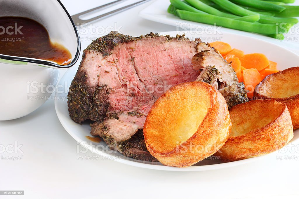 Yorkshire pudding and roast beef dinner stock photo