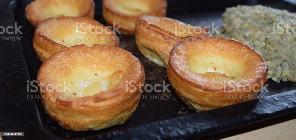 yorkshire pudding batters food on baking tray roast dinner stock photo