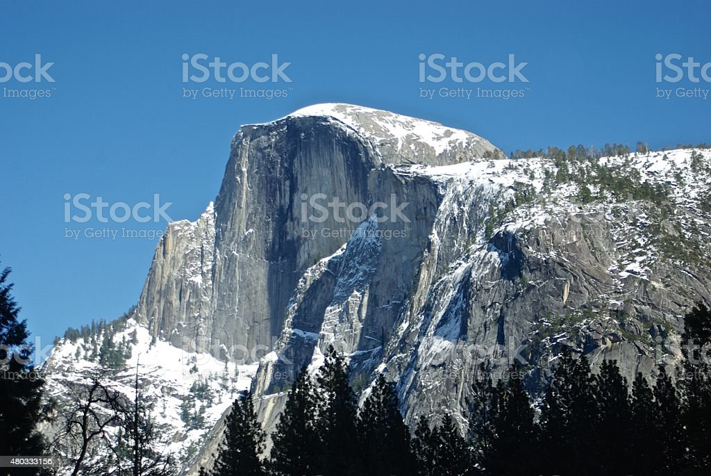 Yosemite Half Dome Under Snow and Blue Sky stock photo
