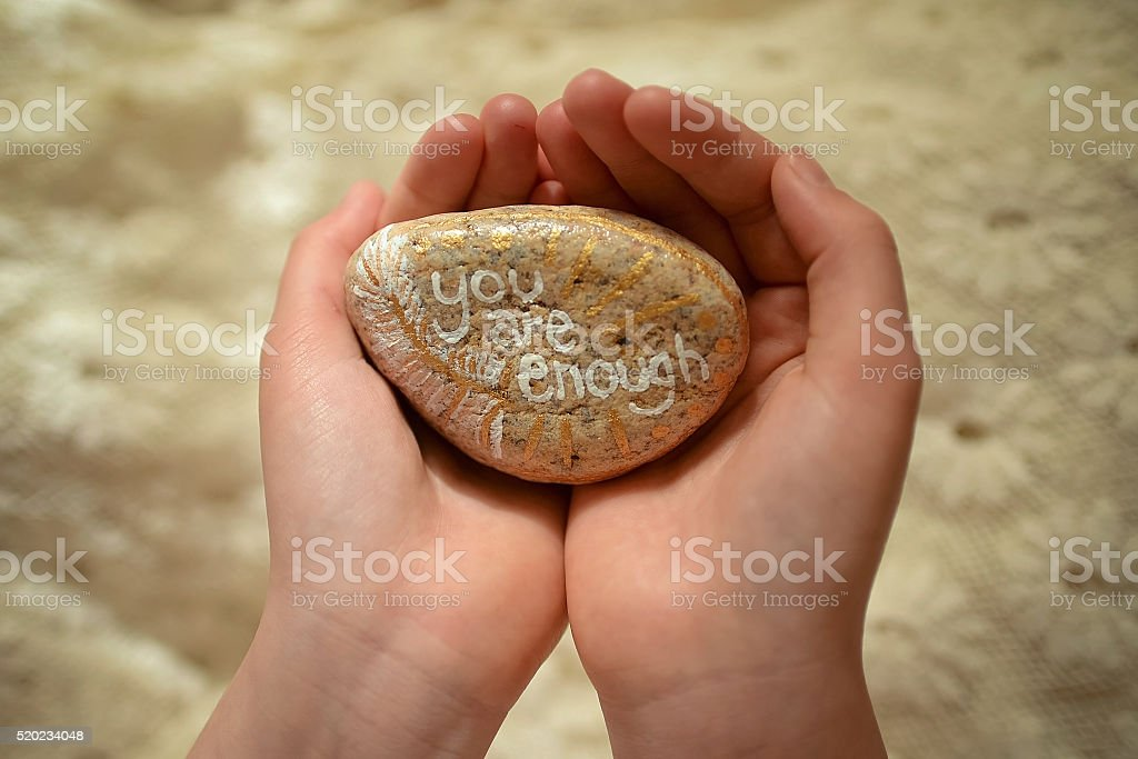You Are Enough painted rock stock photo